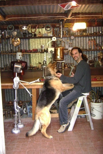 Artist and dog in the shop
